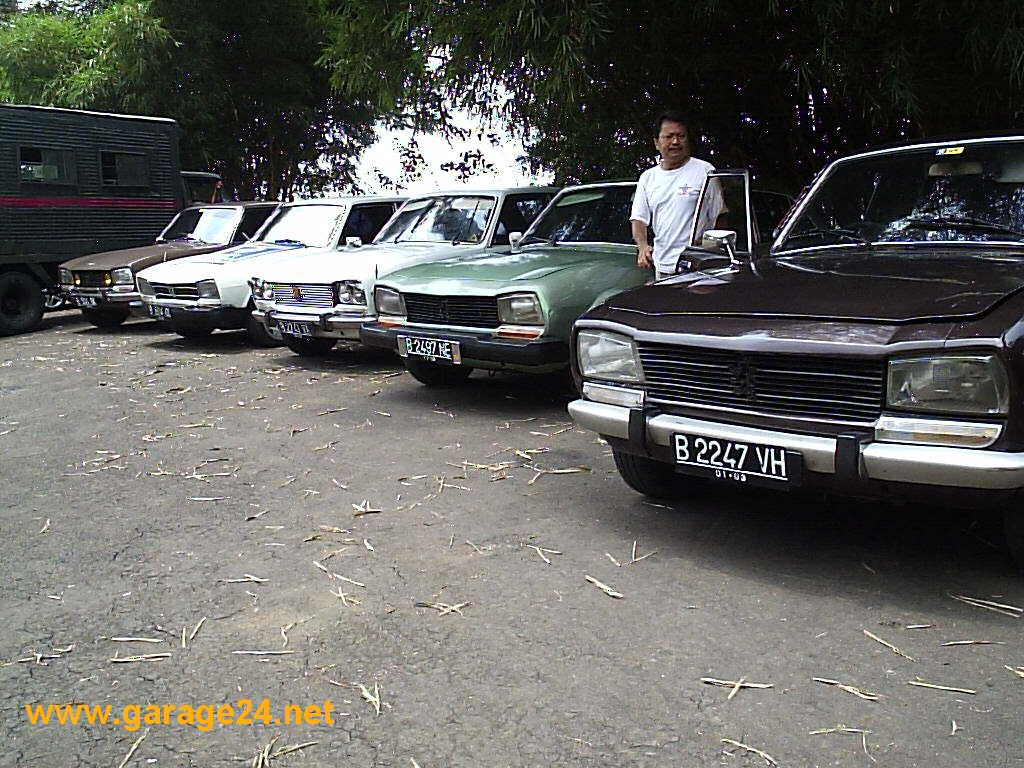 with his 1980 PEUGEOT 504,